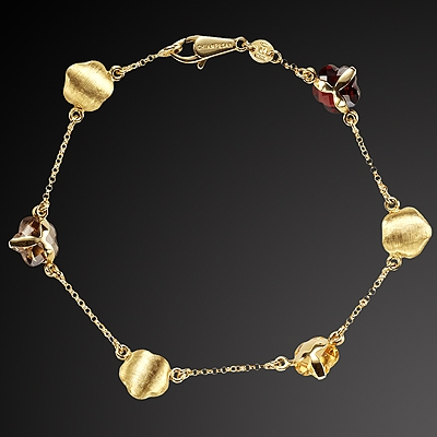 Gold bracelet K-18 with semi precious stones from Chiampesan jewelery house