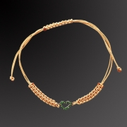 Bracelet from pink gold K-18 with tzavorites in beige lace.