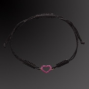 Bracelet from pink gold K-18 with rubins in black lace.